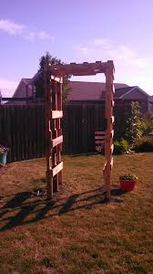 a arbor trellis made from two old pallets and two old windows