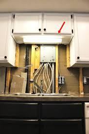 fluorescent under cabinet light led lighting over kitchen sink with diy upgrade led under cabinet