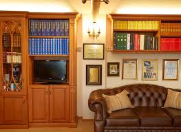 opulent fitted library in shades of oak strachan