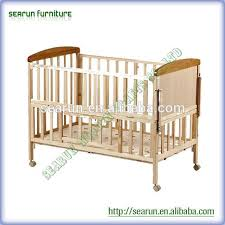 solid wood baby crib solid wood baby crib suppliers and