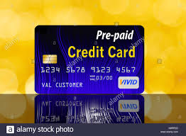 prepaid credit card prepaid credit card on a reflective surface with yellow background