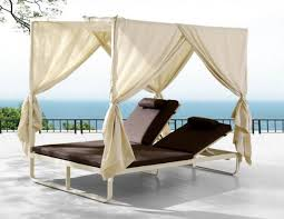 exterior garden daybed with white canopy and curtain using double