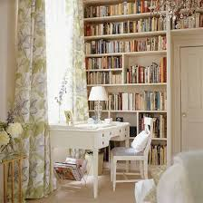 home office country style with bookcases and floral curtains and