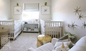 white nursery glider with gold wall stars transitional nursery