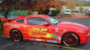 cars like a mustang mustang pimped out to look like lightning mcqueen from cars