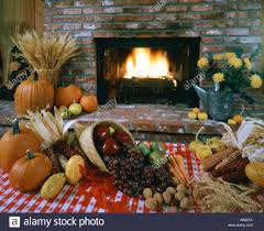 harvest still life with blazing fireplace stock photo royalty