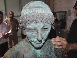 fisherman nets centuries old statue of greek god apollo in gaza