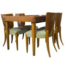 art deco walnut dining table with four chairs by jindrich halabala