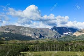 mountain backdrop high rocky mountains create a backdrop for green landscape of