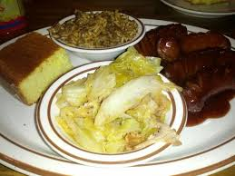 sausage fried cabbage dirty rice and corn bread yelp