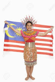 Flag Clothing Woman In Traditional Clothing Holding Up A Malaysian Flag Stock