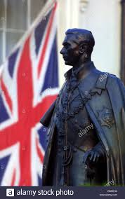 Vi Flag Pictures Union Jack Flies At Half Mast Behind The Statue Of King George Vi