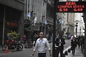 bureau de change ile de a watches the currency exchange values in the buy sell board of