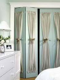 dressing up bi fold closet doors i need to try a version of this