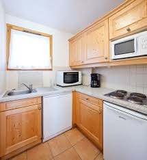 white subway tile kitchen off white subway tile in small kitchen spaces with oak wood cabinet