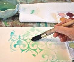love this idea stencil with wax to make a wax resist then