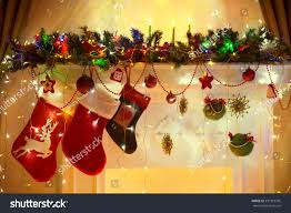 christmas fireplace family hanging three socks stock photo