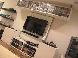 super clean gaming console setup and game room backward