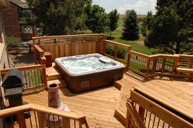 redwood deck with built in seating and tub unique railing