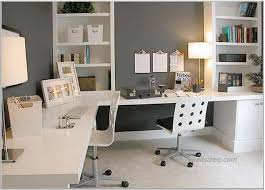 interior home office design idea with white desk chairs gray