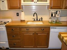 countertops brown paneled cabinets bronze pullouts butcher block