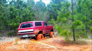 1980 Chevy Mud Truck Go N Green - pulling out a big lifted stuck bronco in the mud youtube