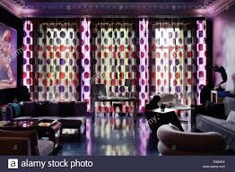Light Purple Curtains Desk In Window Backlit With Red And Purple Spotted Curtains And
