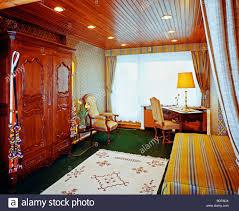 Home Office With Sofa 1970s Home Office With Sofa And Large Wardrobe Stock Photo