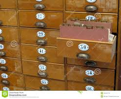 library file cabinet with old wood card drawers stock photo
