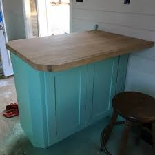 tick tock tick tock the meandering wren as for the peninsula bud had an old piece of butcher block lying around so they cut it to the size we wanted sanded the heck out of it and then screwed