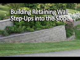 building a retaining wall that u201csteps up u201d the slope is an easy way