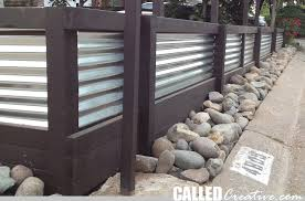 creating a modern wood metal retaining wall fence calledcreative