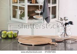 empty cutting board behind kitchen cupboard stock photo 374907514