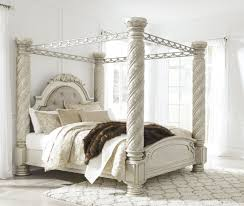 Upholstered Canopy Bed Signature Design By Cassimore Pearl Silver King Upholstered