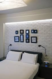 bedroom traditional interior design with faux brick panels and