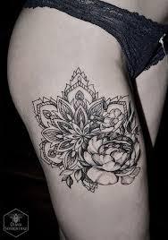 unique black ink mandala flower tattoo on right side thigh