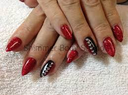gel nails red and black pointed nails glitter and crystals nail