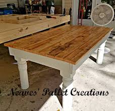 recycled pallet wood dining room table has a classic oak stained