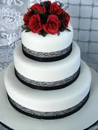 white wedding cake with black ribbon and red roses best images