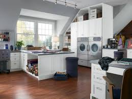interior white themed laundry room idea with storage management