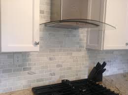 tumbled marble subway tile backsplash trends including tiles