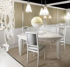luxurious dining room with three chairs white triangle table beige luxurious dining room with three chairs white triangle table beige wall decor white rose on table and three chandeliers image