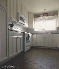 white kitchen cabinets refinishing what you need to before painting cabinets the palette