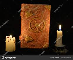 old book of fairy tales with burning candles u2014 stock photo