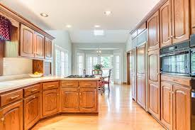 white kitchen cabinets wood trim the shade of white wall paint for oak trim laurel home