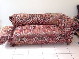 vintage victorian style sofa victorian drop arm sofa with red abstrac pattern fabric cover and