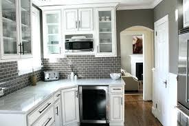 black glass tiles for kitchen backsplashes black glass tile backsplash juniorderby me