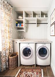 small and narrow laundry room design with washer and dryer under