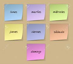 color paper color paper notes with handwritten weekdays in spanish stock photo