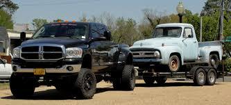 badass trucks bad jacked up dodge ram dually hauling rat rod ford truck barn